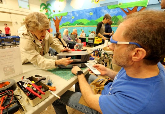Scott Marchfeld of New City helps repair a CD player belonging to Terry Wengryn of Suffern at the Repair Cafe at the Rockland BOCES' Jesse J. Kaplan School in West Nyack May 5, 2019. Volunteers were on hand to repair items including electronics, cell phones, furniture and jewelry. The event was  sponsored and hosted by Rockland County and itsÊSolid Waste Management Authority and Conservation & Service Corps. Another Repair Cafe will be held in Suffern on October 20th.