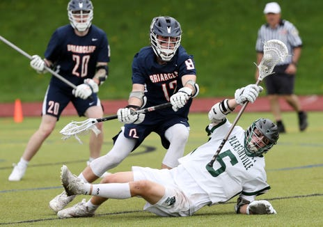 Briarcliff's Nick Reish (12) puts pressure on  Pleasantville's Pat Doherty (5) during boys lacrosse action at  Pleasantville High School May 4, 2019. Briacliff won the game 9-8.