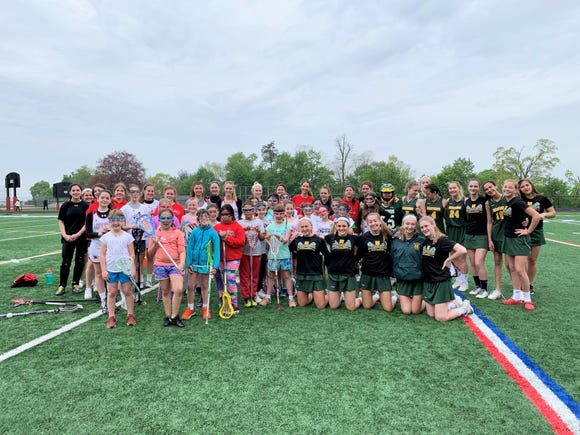 Hastings and Sleepy Hollow high school girls lacrosse players with younger kids at May 4, 2019 clinic.