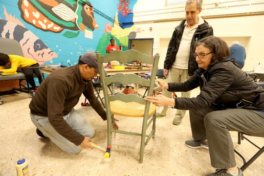 Sri Venkatesan of Stony Point, left, helps repair a chair belonging to Kathy and Antoine Rodenbach of West Nyack at the Repair Cafe at the Rockland BOCES' Jesse J. Kaplan School in West Nyack May 5, 2019. Volunteers were on hand to repair items including electronics, cell phones, furniture and jewelry. The event was  sponsored and hosted by Rockland County and itsSolid Waste Management Authority and Conservation & Service Corps. Another Repair Cafe will be held in Suffern on October 20th.