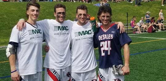 DeSales lacrosse players from Delaware Kai Taylor (Wilmington Charter),  Zach Bowen, (Appoquinimink), Nick Bowen (Appoquinimink) and Noah Tuohey (MOT Charter) after MAC Freedom championship Saturday earned DeSales an NCAA Division III Tournament berth.
