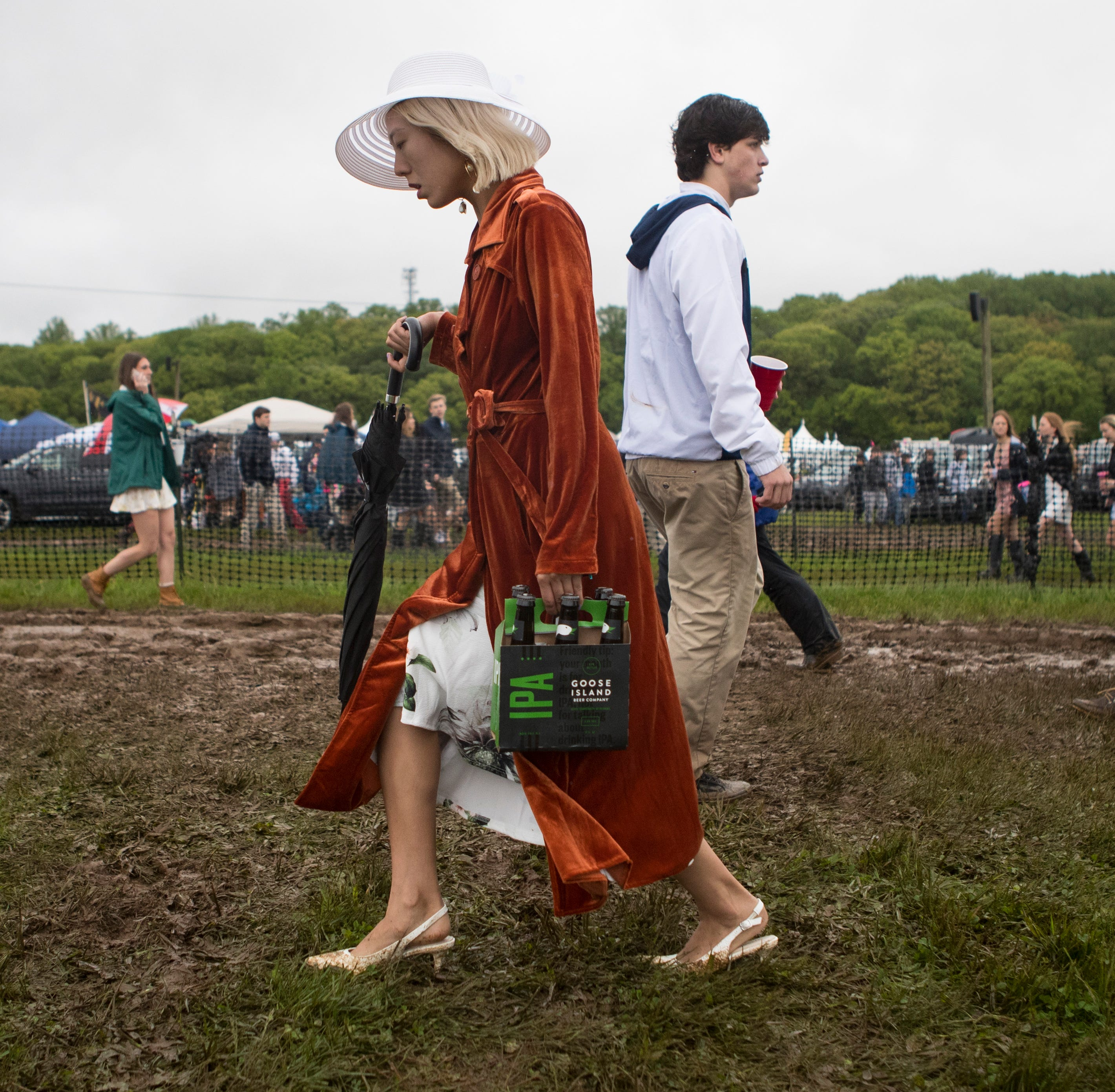 'You get dirty:' Guests tromp through mud at rain-logged Point-to-Point at Winterthur