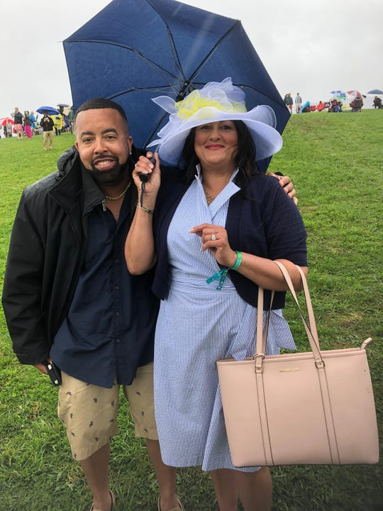 Christina Anderson thought about wearing something more practical to the Point-to-Point Steeplechase at Winterthur Sunday. But her husband, Garry, told her to go with the dress.