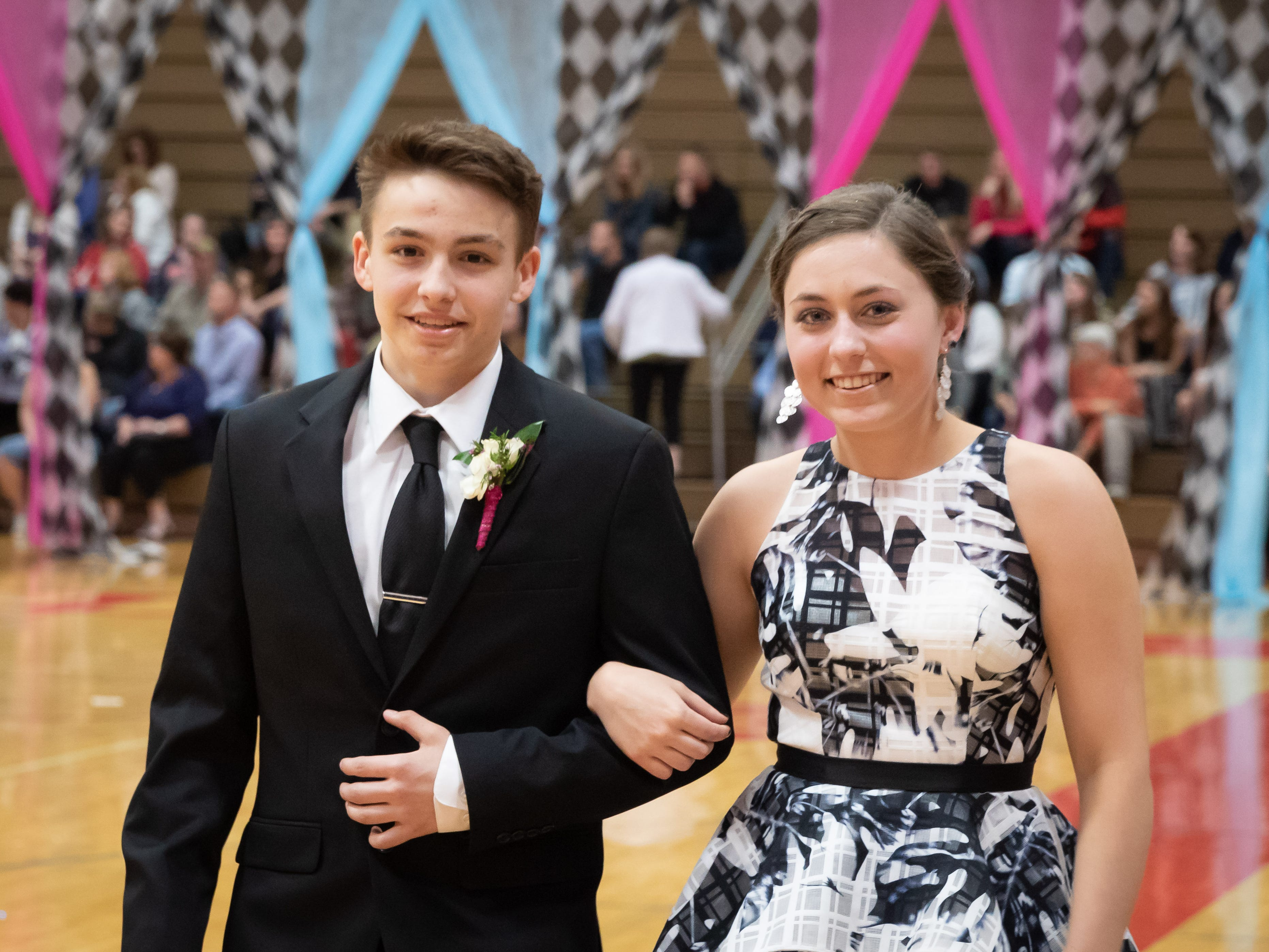 Students participate in the grand march during the Lincoln High School prom on Saturday, May 4, 2019, at the high school in Wisconsin Rapids.
