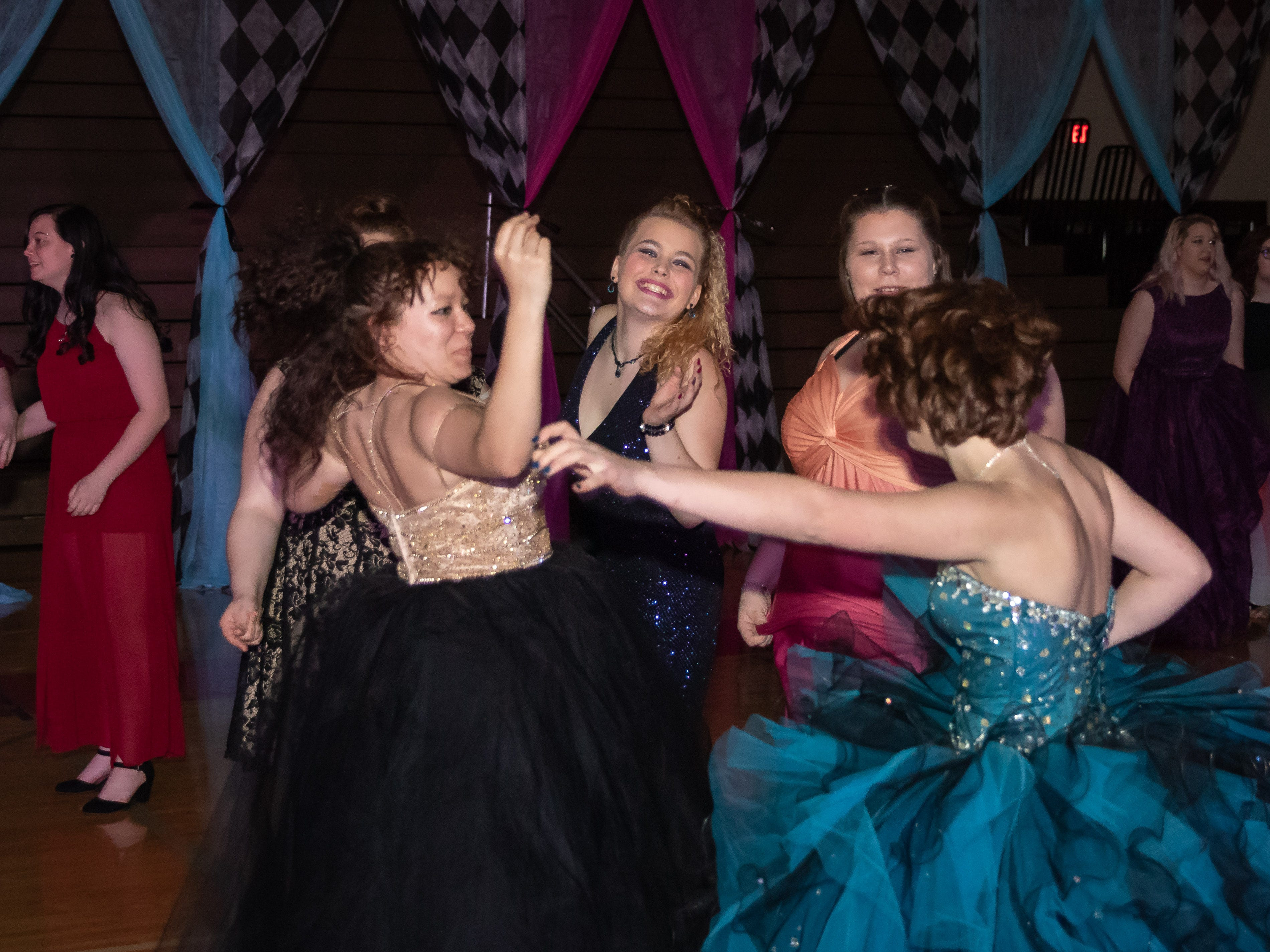 Students dance during the Lincoln High School prom on Saturday, May 4, 2019, at the high school in Wisconsin Rapids.