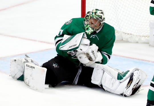 Dallas Stars goaltender Ben Bishop grimaces after being hit by a puck during the third period in Game 6.