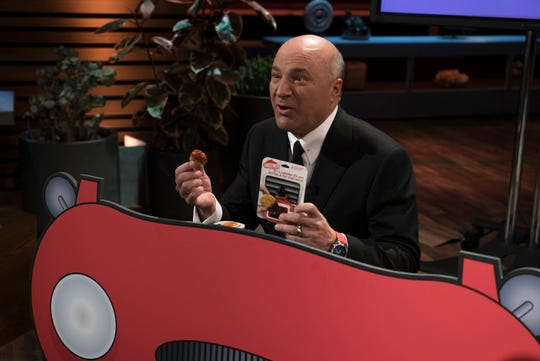"Shark Kevin O'Leary is hooked on Saucemoto, a dipping sauce holder that attaches to the air vent of a vehicle, offered on ""Shark Tank."""
