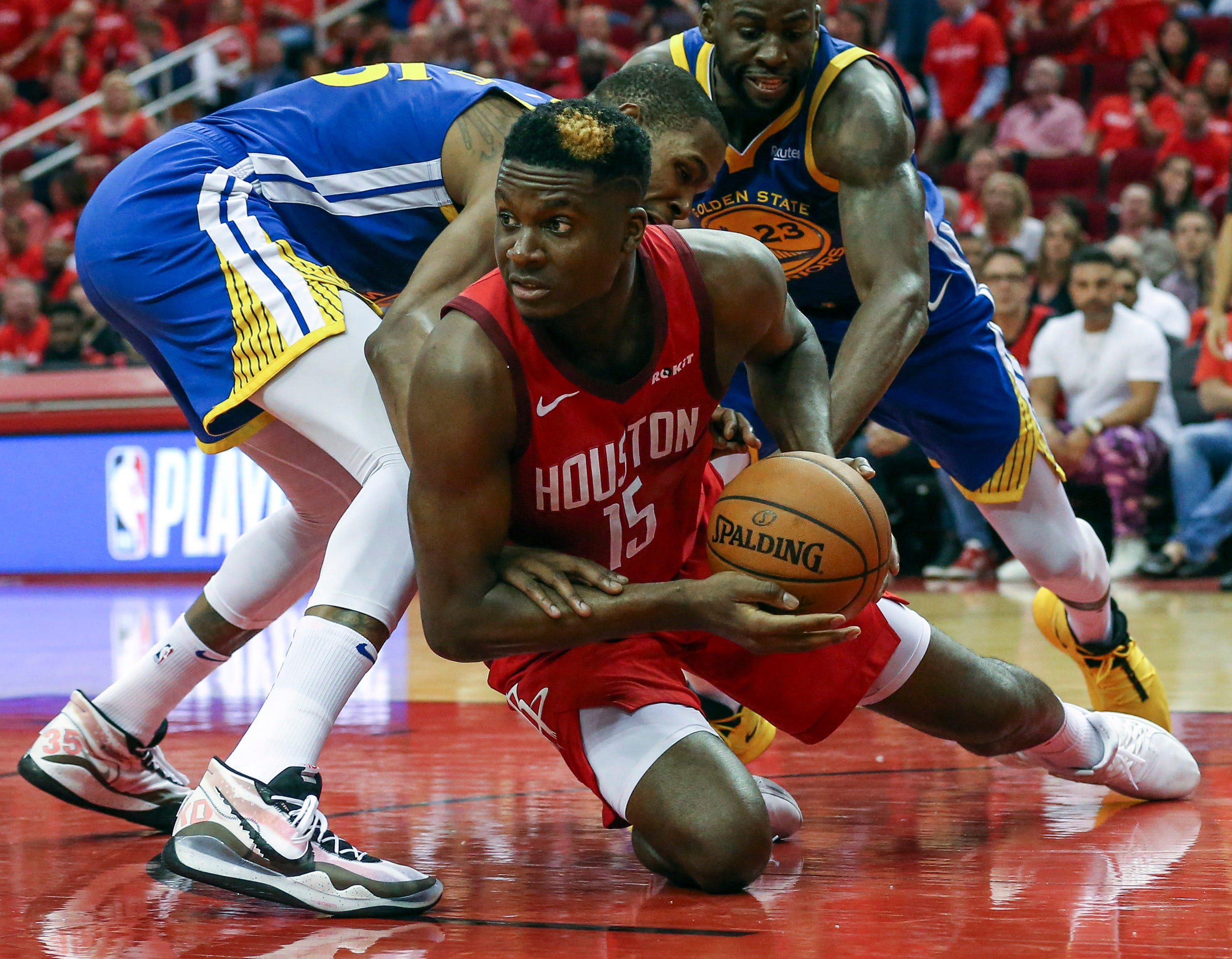 May 4: Rockets center Clint Capela (15) hits the floor to corral a loose ball during Game 3 against the Warriors.