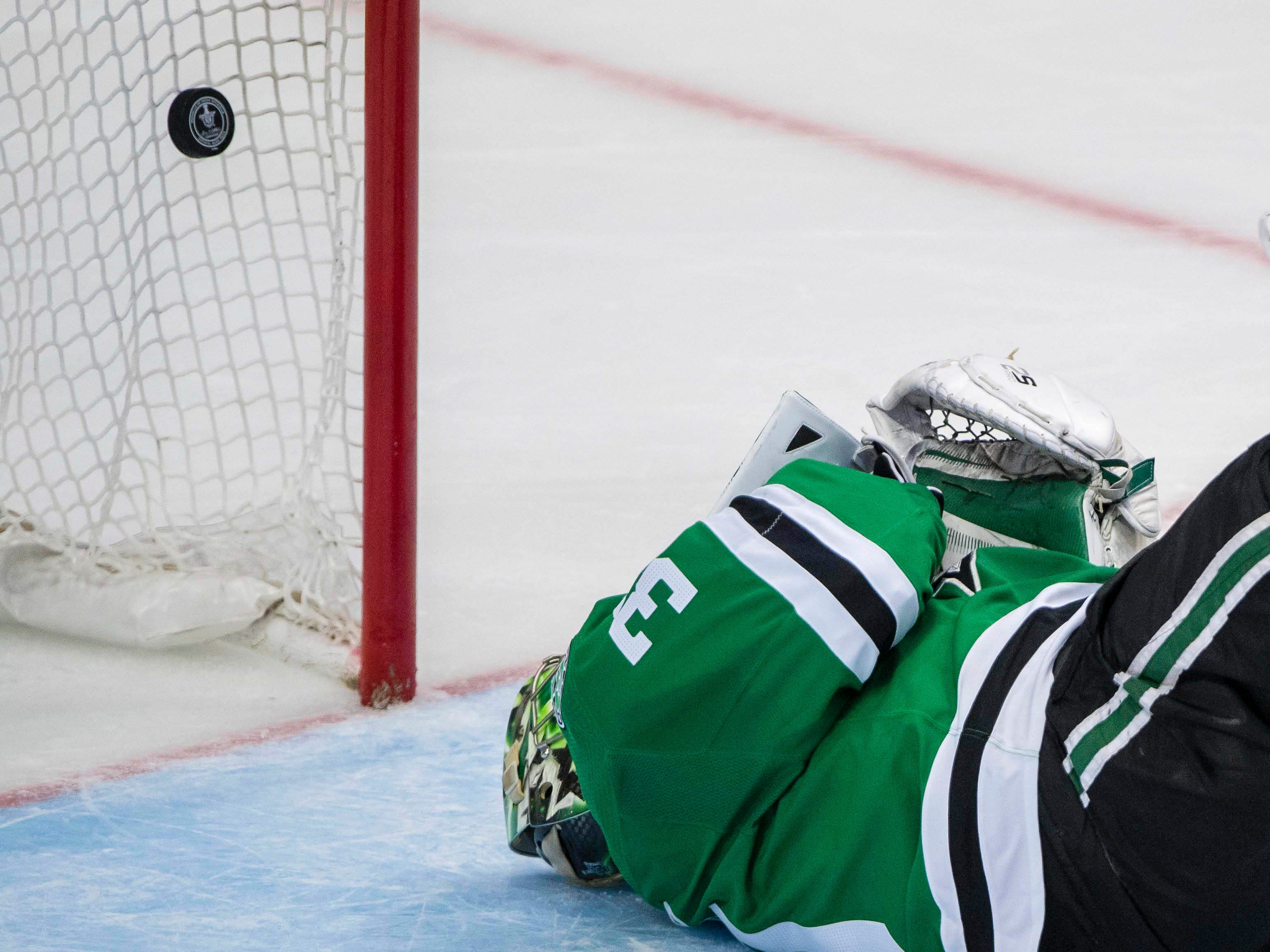Second round: Stars goalie Ben Bishop lies on the ice after being injured. The Blues maintained possession of the puck and Jaden Schwartz scored on a deflection while Bishop was down.