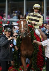Flavien Prat aboard Country House in the winner's circle during the 145th running of the Kentucky Derby.