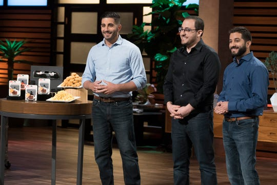 """Cleveland entrepreneurs Tony Lahood, William Moujaes and Michael Koury present Saucemoto, their handy device that helps you enjoy fast-food condiments on the go, on """"Shark Tank."""""""