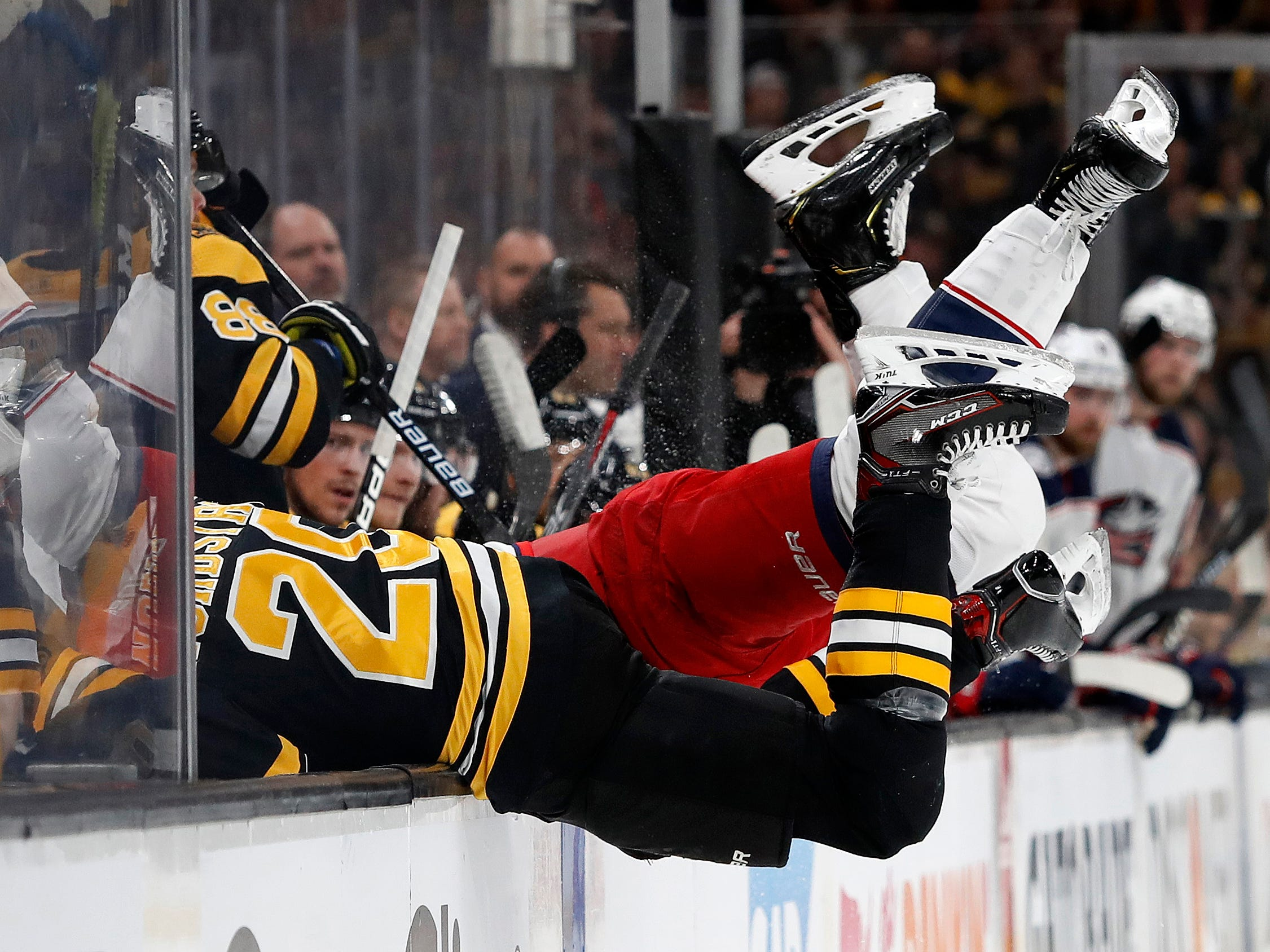 Second round: Bruins center Joakim Nordstrom and Blue Jackets left wing Nick Foligno fall into the bench after colliding during the first period of Game 5.