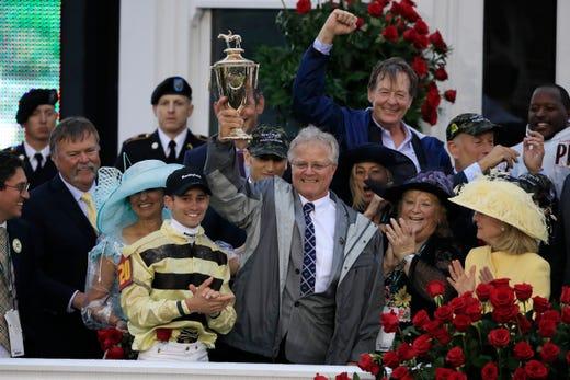County House trainer Bill Mott and jockey Flavien Prat celebrate with the Kentucky Derby trophy.