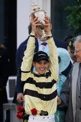 Flavien Prat, jockey of Country House,  celebrates after winning the Kentucky Derby.