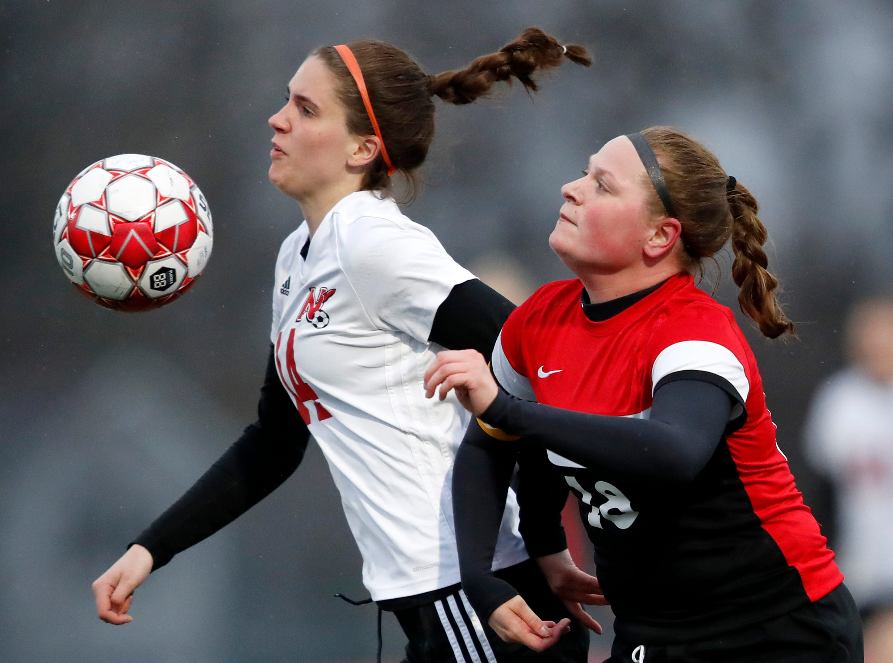Neenah High School's Cami Basler chests the ball away from Kimberly High School's Lexi Huntington Tuesday, April 30, 2019, in Kimberly, Wis. Danny Damiani/USA TODAY NETWORK-Wisconsin