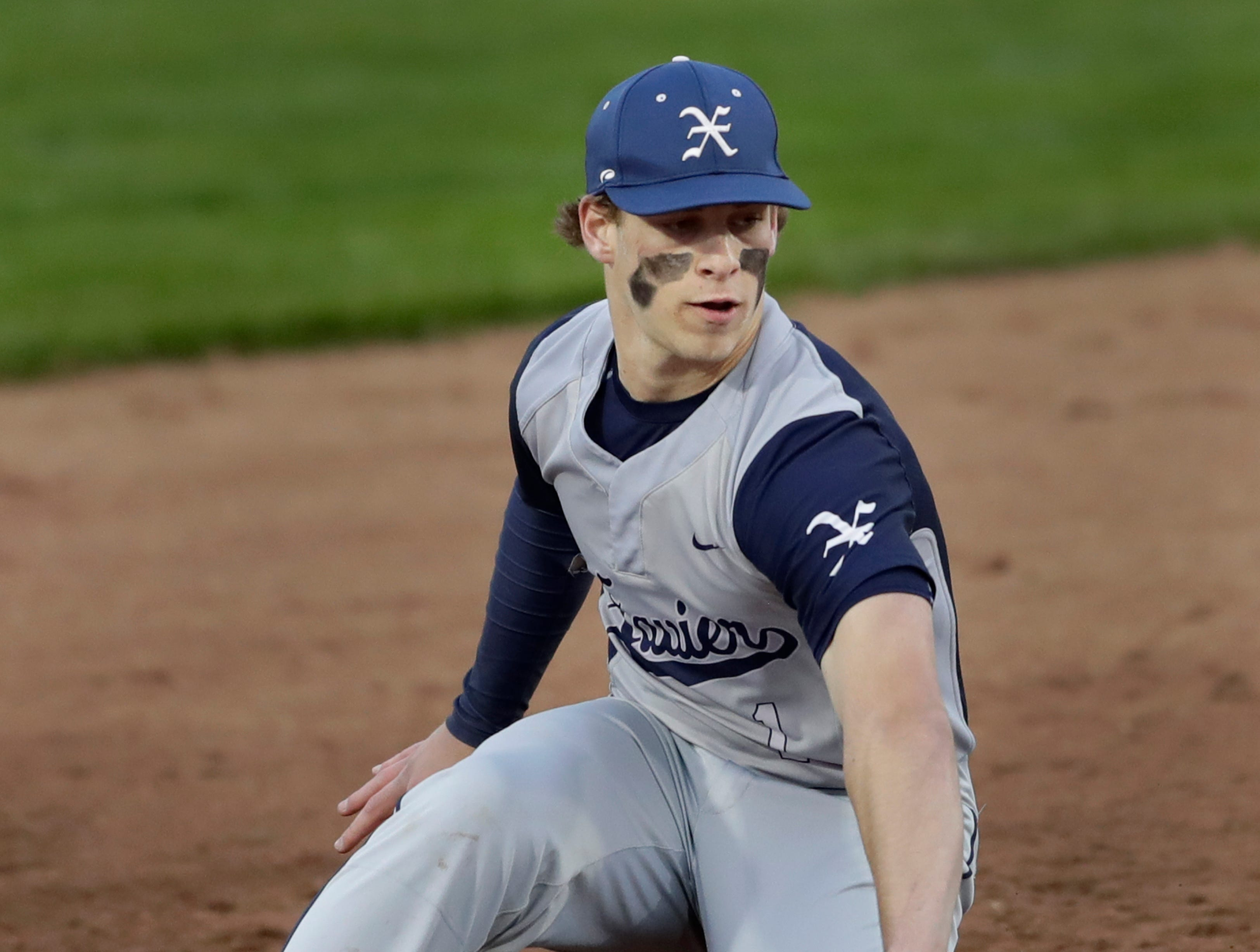 Xavier High School's TJ Van Eperen (1) fields an infield hit against Menasha High School during their boys baseball game Thursday, May 2, 2019, at Don Hawkins Field in Grand Chute, Wis. Dan Powers/USA TODAY NETWORK-Wisconsin