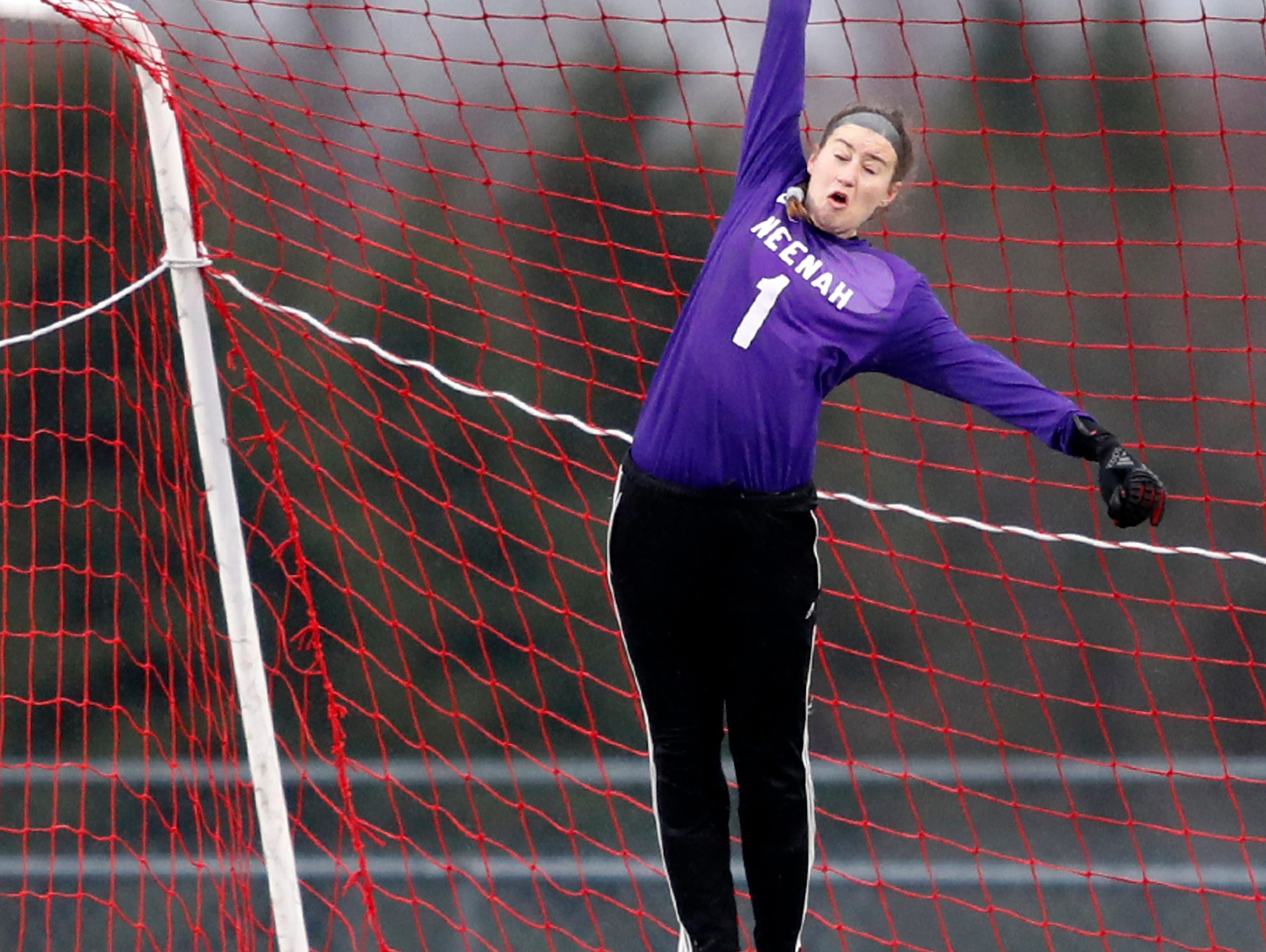 Neenah High School's goalkeeper McKenna Krueger leaps into the air to try and make a save against Kimberly High School Tuesday, April 30, 2019, in Kimberly, Wis. Danny Damiani/USA TODAY NETWORK-Wisconsin