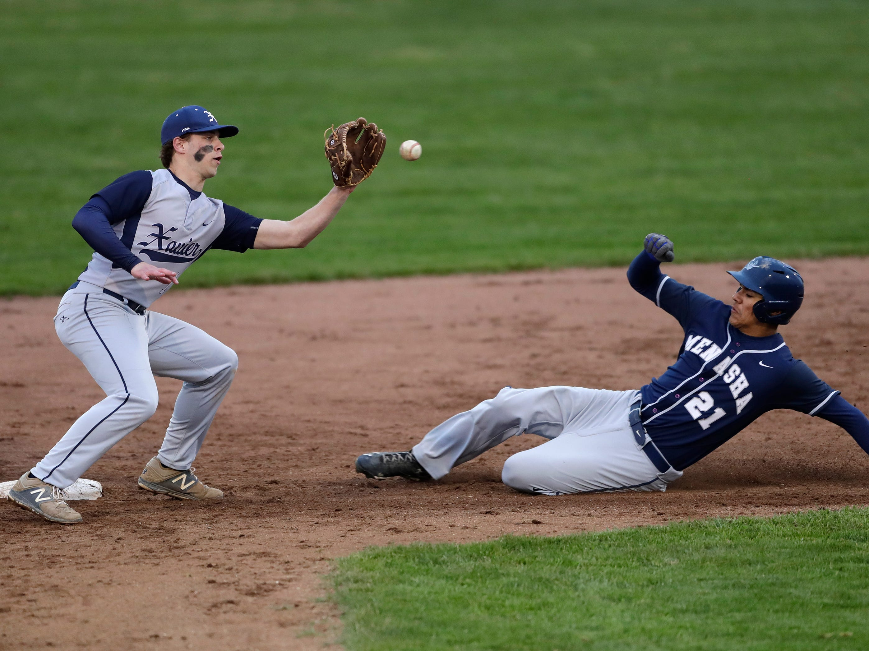 Xavier High School's TJ Van Eperen (1) is late on the tag as Menasha High School's Sam Wussow (21) is safe at second base during their boys baseball game Thursday, May 2, 2019, at Don Hawkins Field in Grand Chute, Wis. Dan Powers/USA TODAY NETWORK-Wisconsin