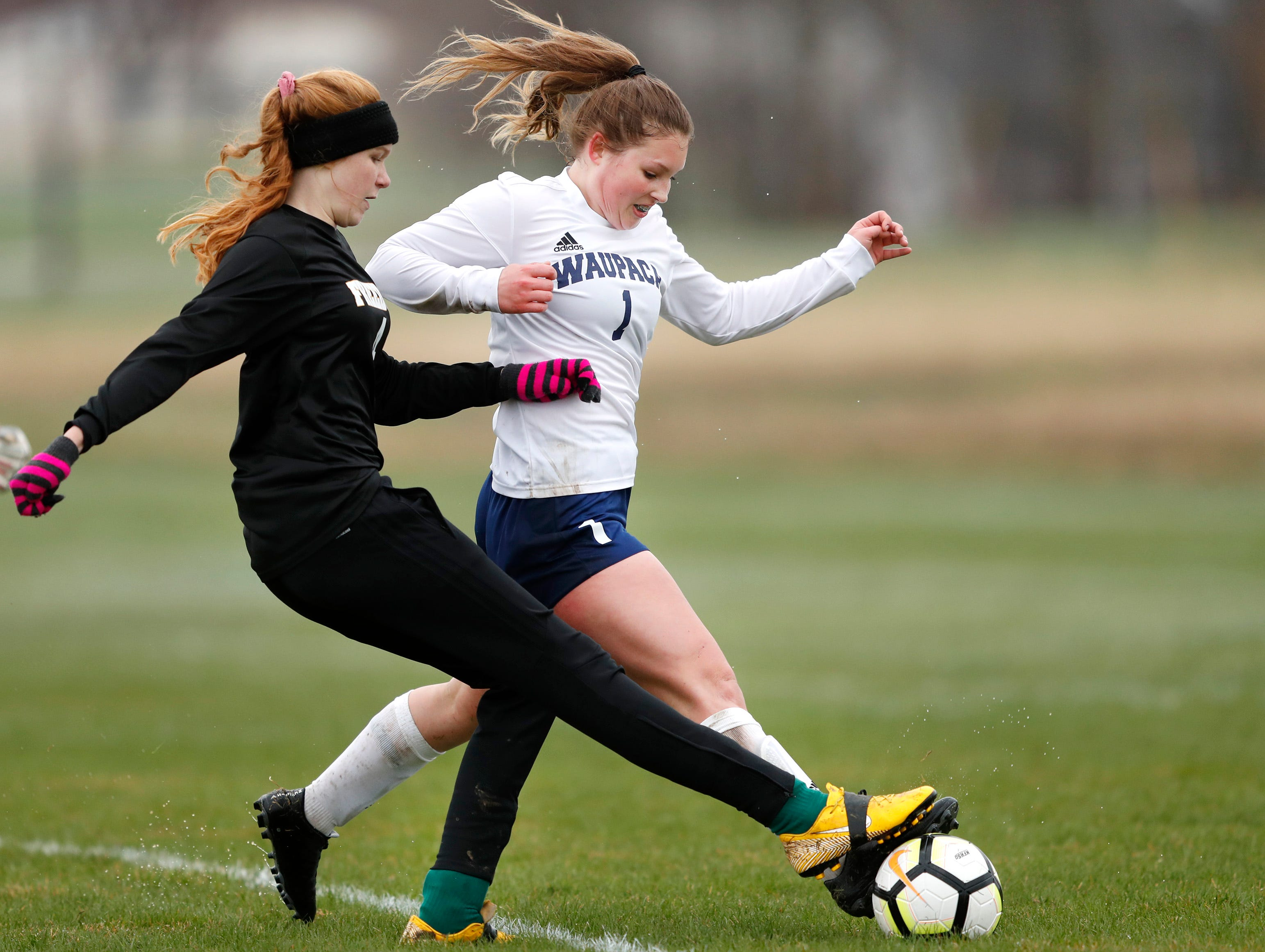 Waupaca High School's Autumn Wennesberg gets a foot to the ball as she defends an open net against Freedom High School's Hailey Weyenberg Monday, April 29, 2019, in Freedom, Wis. Danny Damiani/USA TODAY NETWORK-Wisconsin