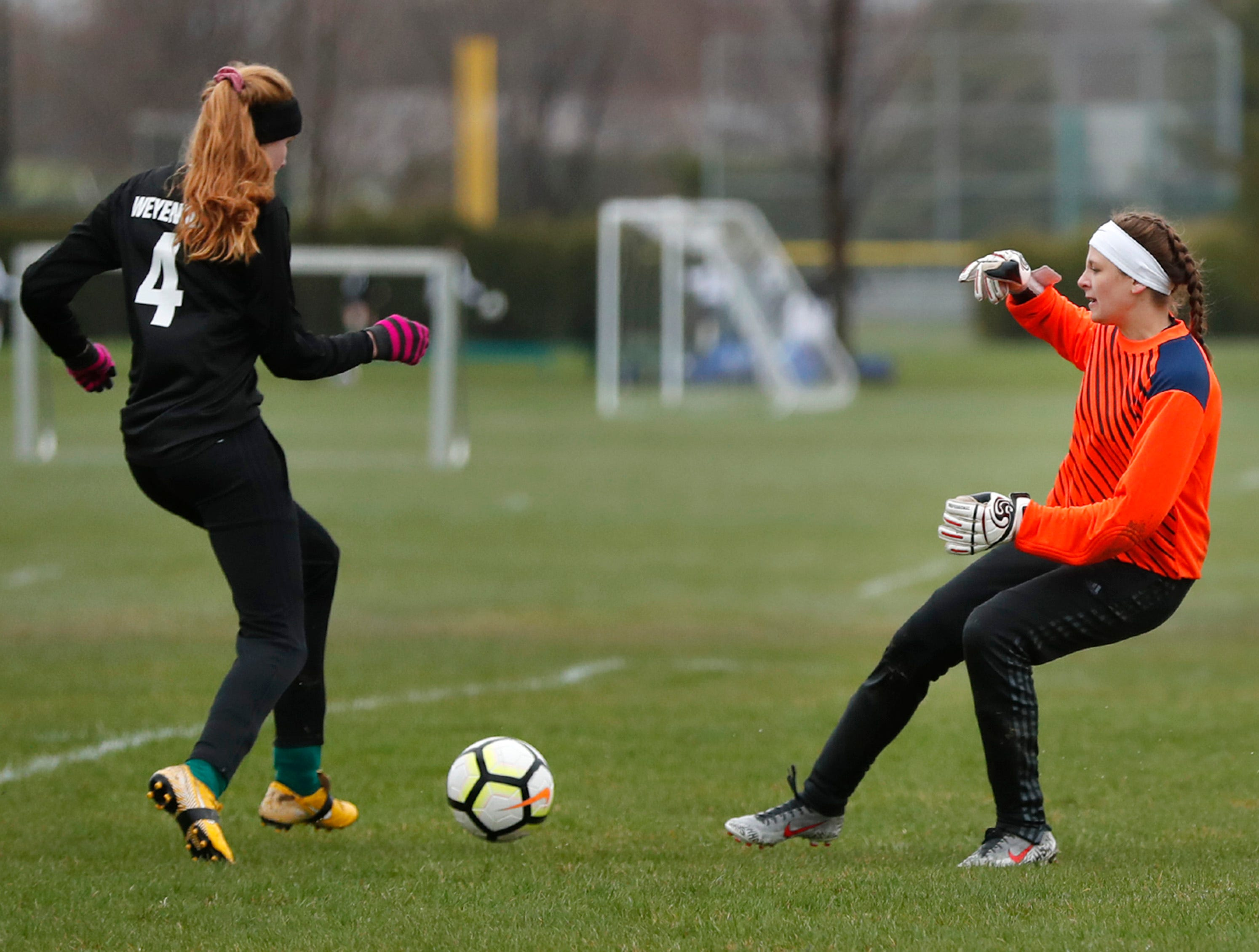 Freedom High School's Hailey Weyenberg dribbles the ball around Waupaca High School's goalkeeper Seattle Lettau for a goal Monday, April 29, 2019, in Freedom, Wis. Danny Damiani/USA TODAY NETWORK-Wisconsin