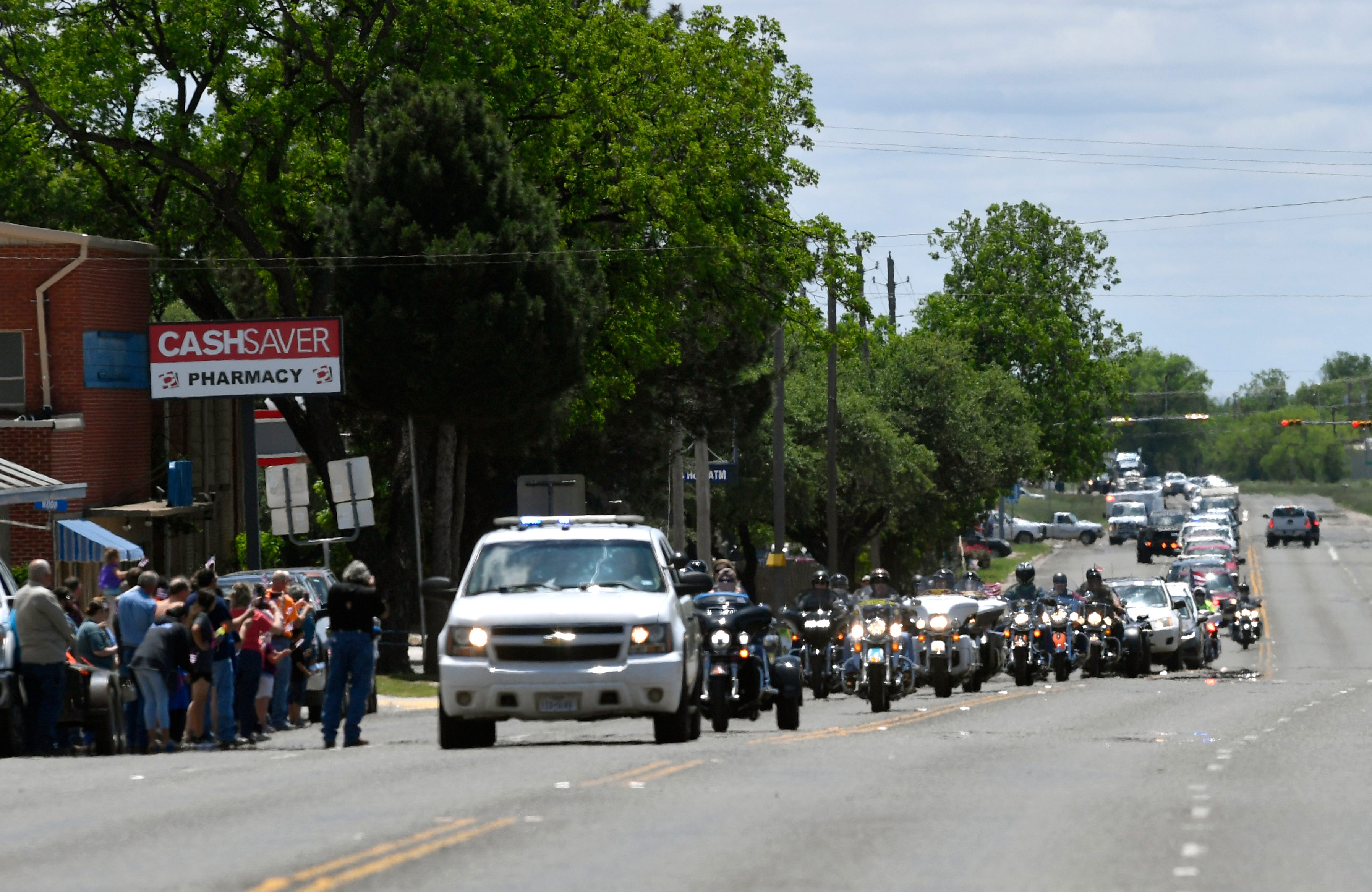 A convoy of Patriot Guard motorcyclists, police officers, veterans and others arrive in Winters, Texas, from Ballinger, Texas, on Saturday, May 4, 2019. They were escorting the remains of Seaman 1st Class Hale McKissack who died at Pearl Harbor on Dec. 7, 1941, but whose remains were only recently identified.