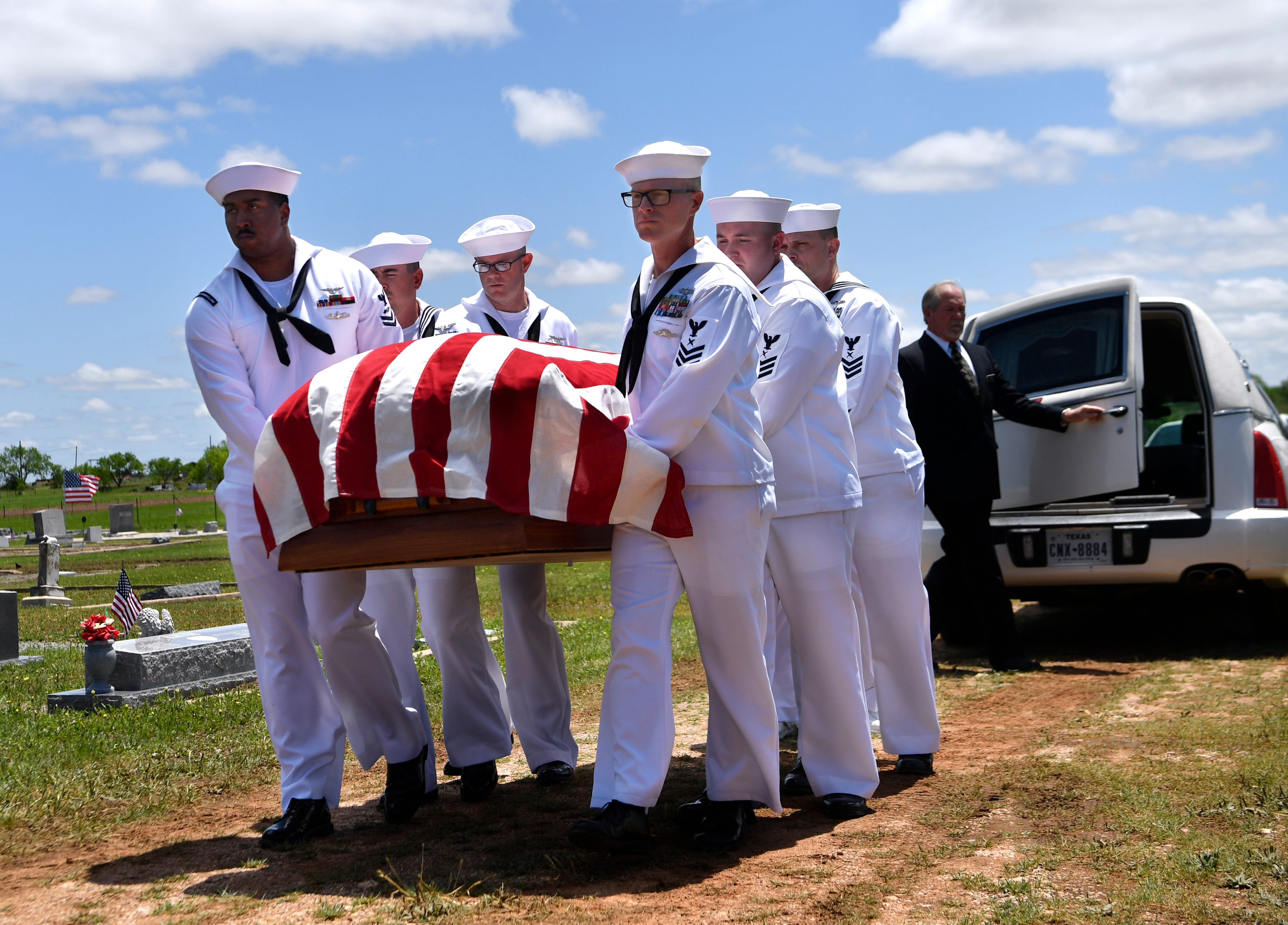 A U.S. Navy honor guard carries the casket of Seaman 1st Class Hale McKissack at Fairview Cemetery in Winters, Texas, on Saturday, May 4, 2019. McKissack was killed during the Japanese attack on Pearl Harbor on Dec. 7, 1941, his remains were only recently identified.
