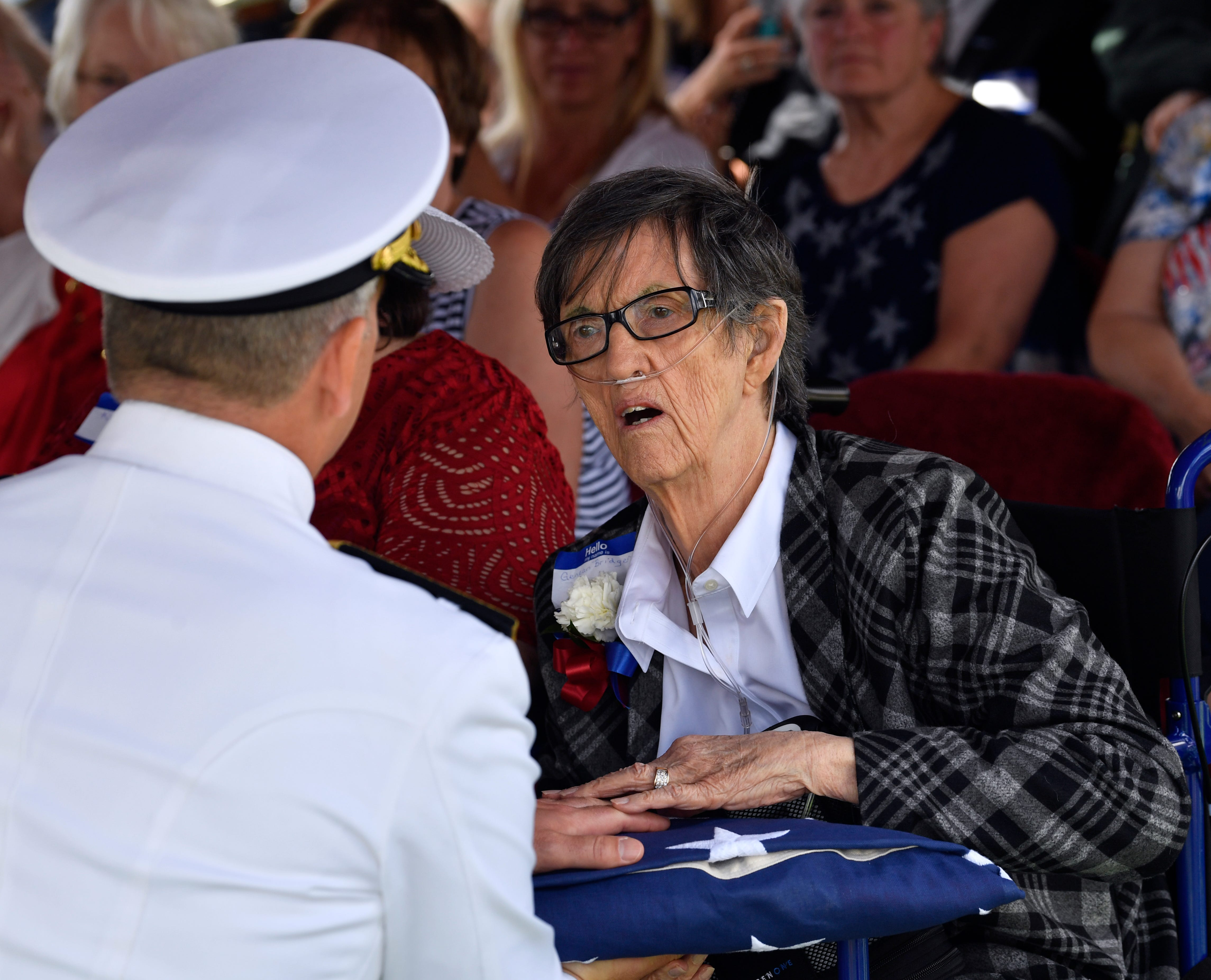 Rear Admiral Ted LeClair, the Deputy Commander of the U.S. 7th Fleet, hands the folded flag to Genean Bridger, the niece of Seaman 1st Class Hale McKissack who was buried Saturday, May 4, 2019, in Winters, Texas. McKissack died during the Japanese attack on Pearl Harbor on Dec. 7, 1941, and it wasn't until 2015 that his remains were identified.