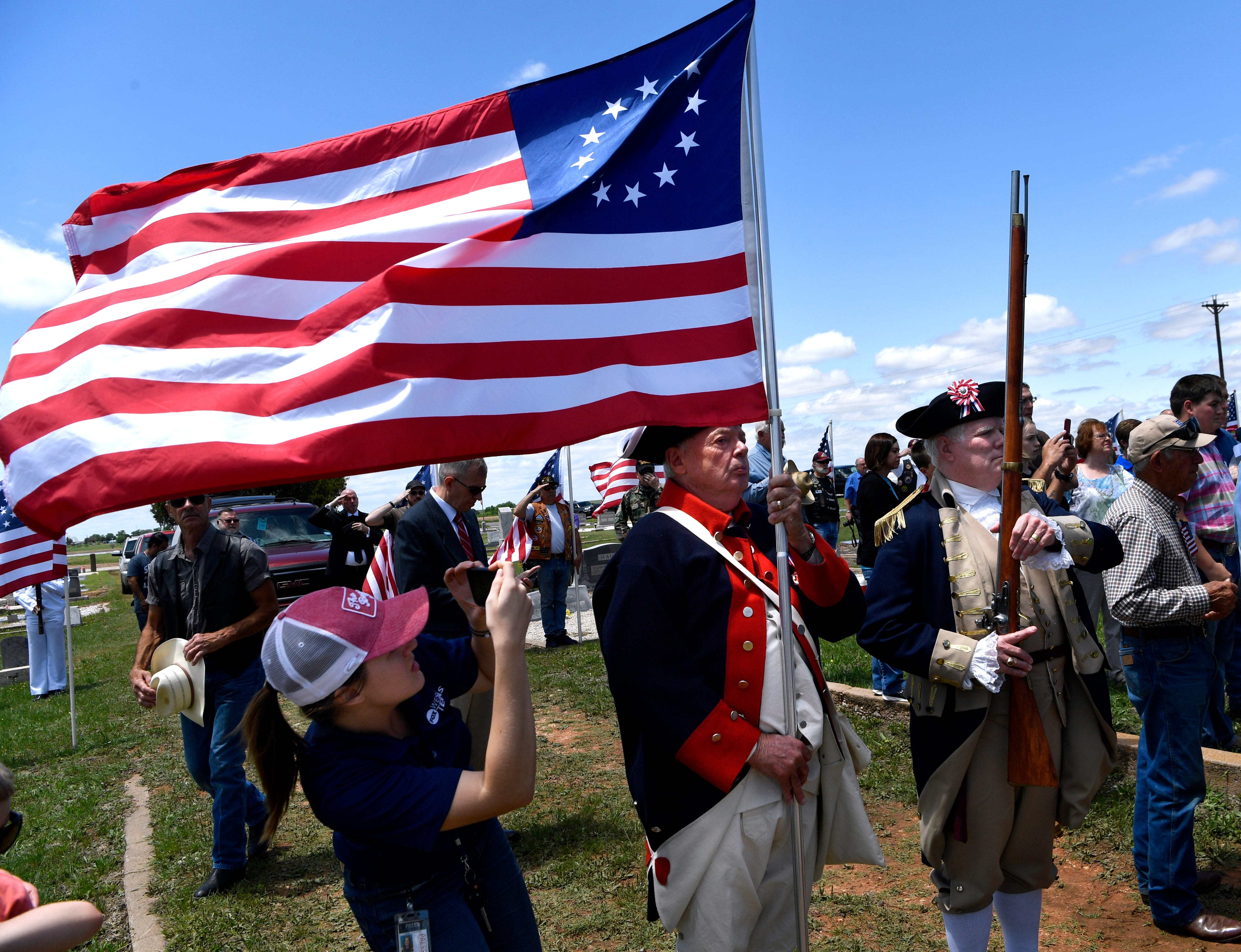 Spectators watch the funeral of Hale McKissack at Fairview Cemetery in Winters, Texas, on Saturday, May 5, 2019. A crowd of veterans, reenactors, and area residents came to pay their respects to McKissack who died during the attack on Pearl Harbor on Dec. 7, 1941.