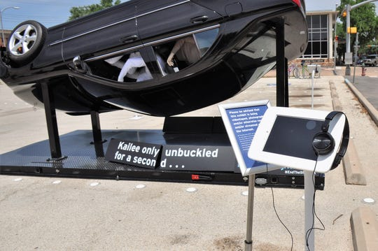 A flipped, airborne sedan with mannequins was set up in the parking lot south of the downtown Abilene library branch for the Click It or Ticket seat belt safety campaign. The Texas Department of Public Safety set up the interactive display with video kiosks stations for a few hours Monday. The kiosks recounted how a 16-year-old Spring girl was killed in a crash after she unbuckled to take a selfie.