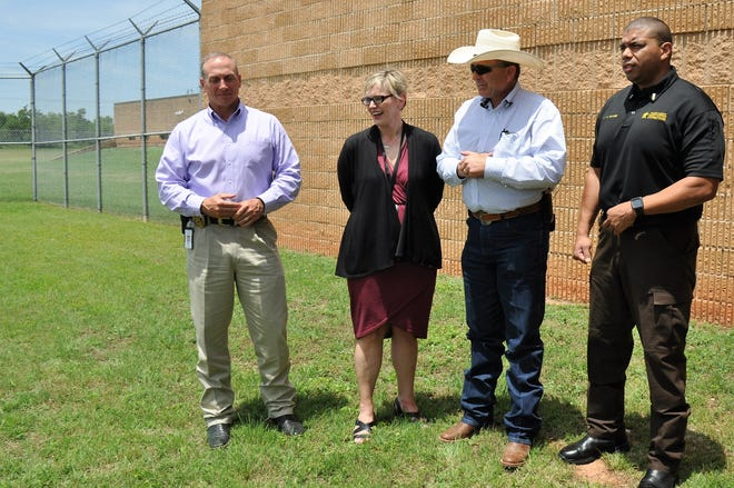 On April 1, a jail navigator started at Taylor County Jail to divert some people in mental health crisis to more appropriate care. Talking about the success of the program so far are, from left, Abilene Police Asst. Chief Mike Perry, Betty Hardwick Chief Executive Officer Jenny Goode, Taylor County Sheriff Ricky Bishop and  Lt. Andre Moore, commander of the jail staff.