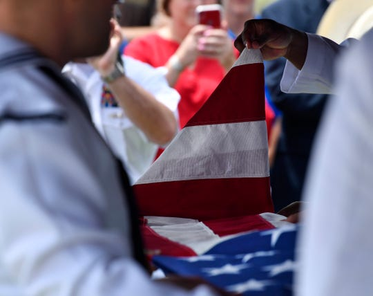 U.S. Navy honor guard members fold the flag over the casket of Seaman 1st Class Hale McKissack during his funeral May 4 in Winters. McKissack was killed at Pearl Harbor on Dec. 7, 1941. It was only in recent years that his remains were identified.