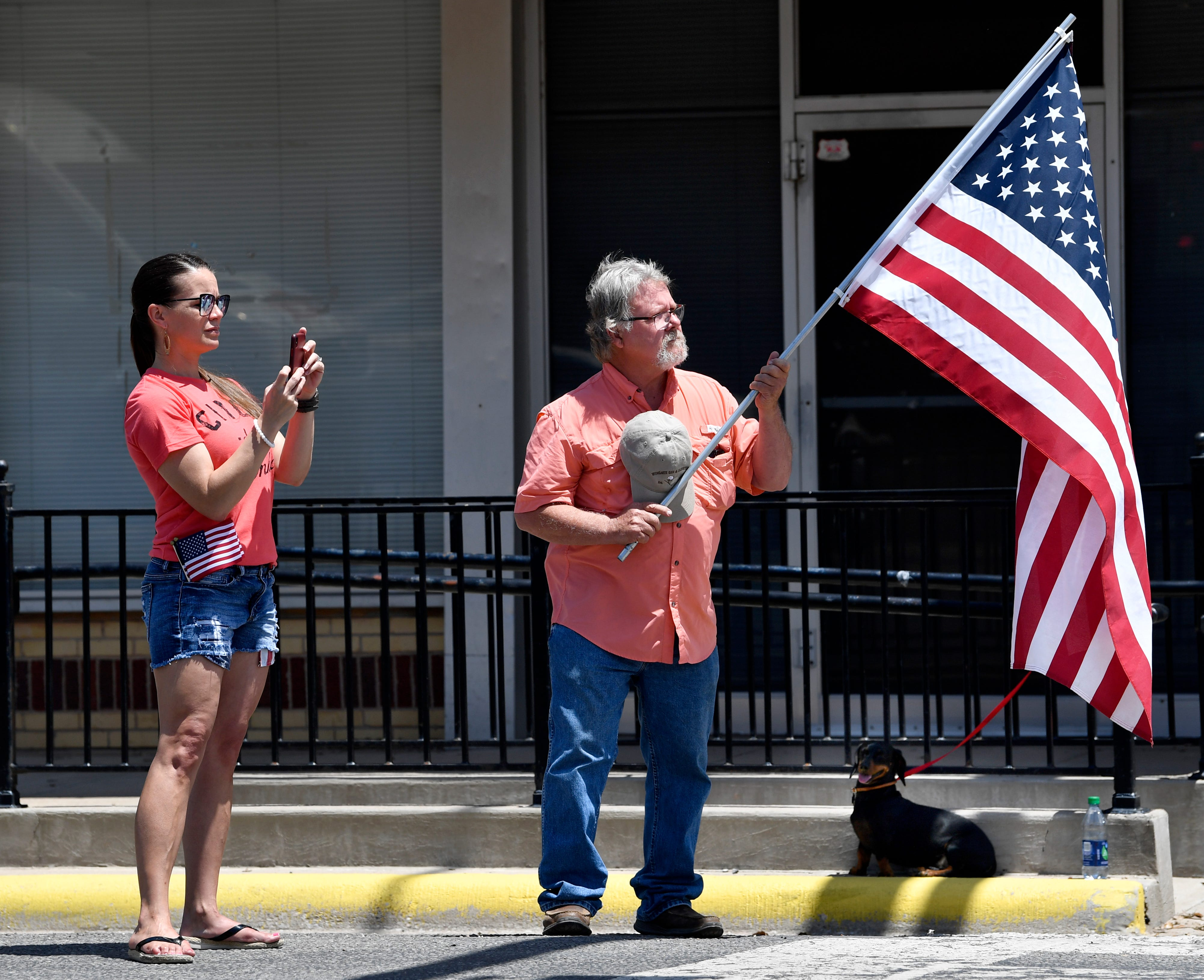 Katy Grimes of Granbury, Texas, stands with her uncle, Roy Brown, watching the funeral procession of Hale McKissack enter Winters, Texas, and then turn toward Fairview Cemetery on Saturday, May 4, 2019. McKissack died at Pearl Harbor on Dec. 7, 1941, his remains were only recently identified.