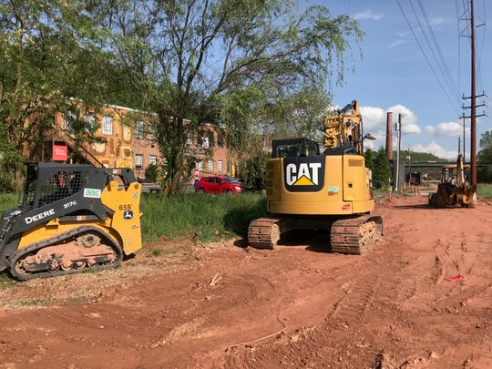 Asheville uses a mix of funding for major construction projects, including property taxes, grants and sales tax revenues. City Council members are proposing Asheville continue a borrowing program to fund a backlog in major projects. Pictured here on May 3, 2019, is infrastructure construction in the River Arts District.