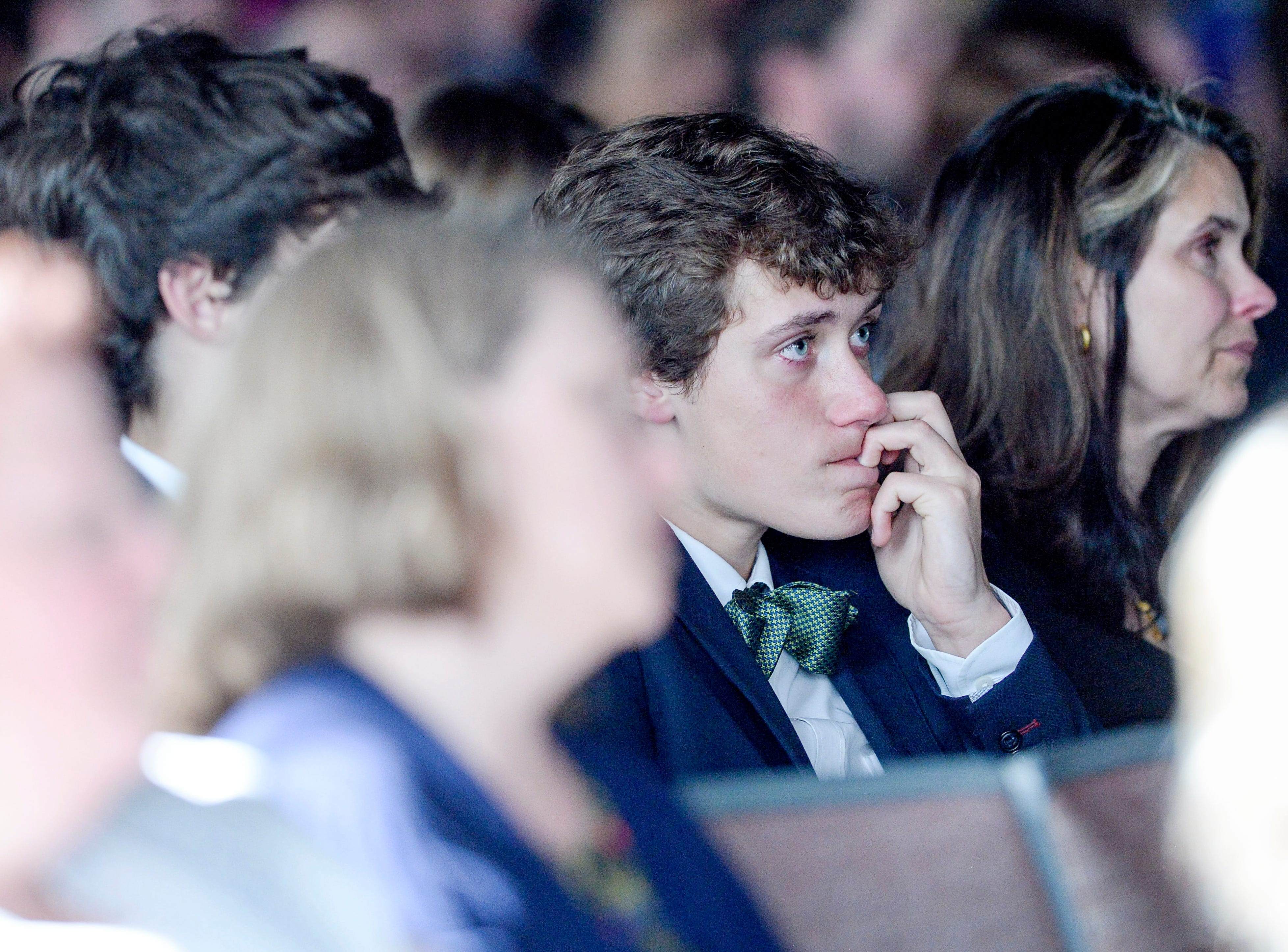 People listen during a memorial service for Riley Howell at Stuart Auditorium in Lake Junaluska May 5, 2019.