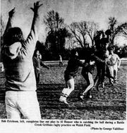 Bob Erickson, left, throws a line out to Al Houser during a 1977 Battle Creek Griffons rugby practice at Walsh Field.