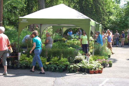 Customers explore the offerings of more than 20 local vendors at the Black Mountain Garden Sale last year. The event returns to the Monte Vista Hotel on May 17 and 18.