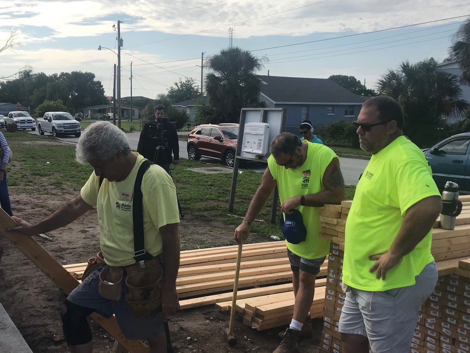 A prayer of blessing is said after walls were raised Monday morning on the first of six homes for female veterans to be built in Cocoa by Habitat for Humanity of Brevard. This home will go to Army veteran Karla Griggs.