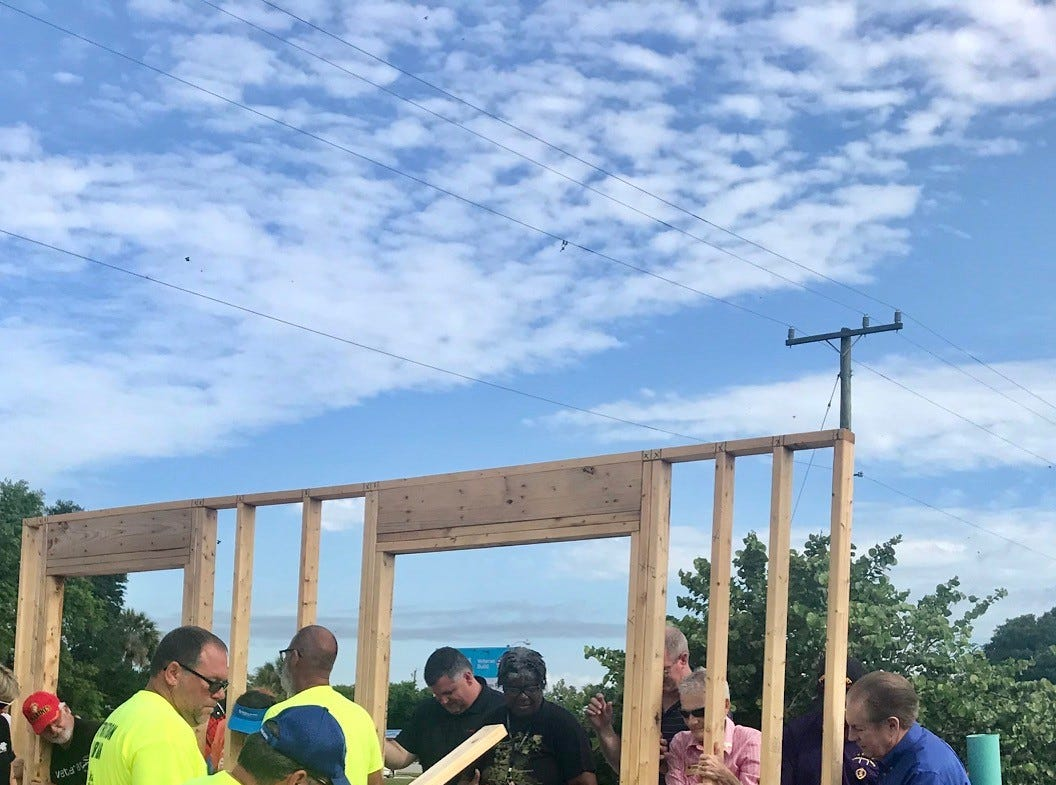 The walls were raised Monday morning on the first of six homes for female veterans to be built in Cocoa by Habitat for Humanity of Brevard. This home will go to Army veteran Karla Griggs.