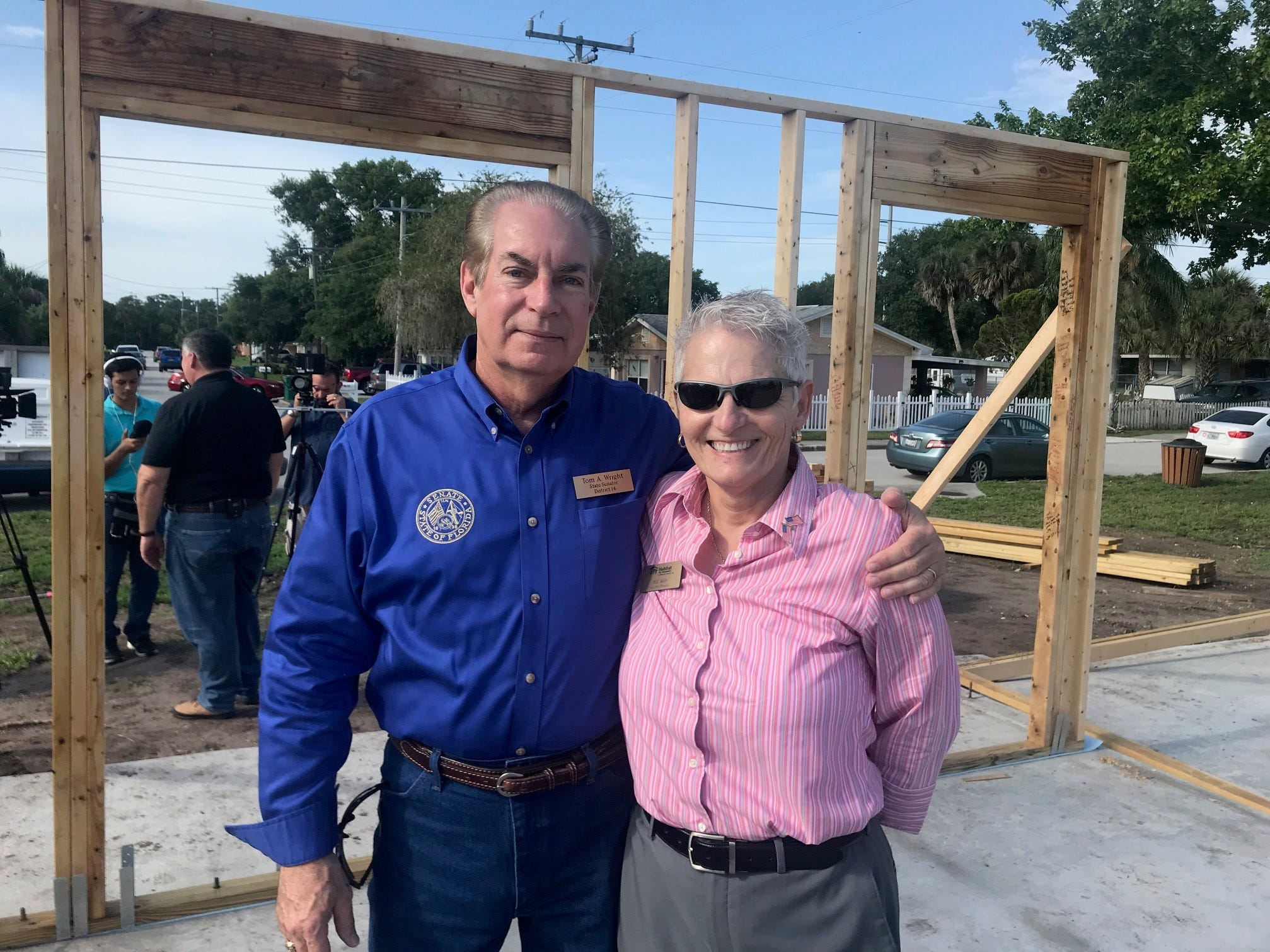 State Sen Tom Wright and Mary Kelly, executive director of Habitat for Humanity of Brevard, pose for a photo after walls were raised Monday morning on the first of six homes for female veterans to be built in Cocoa by Habitat for Humanity of Brevard. This home will go to Army veteran Karla Griggs.