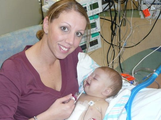 Corrine Kamon holds her daughter Rayna Kamon after undergoing liver transplant surgery nearly 10 years ago.