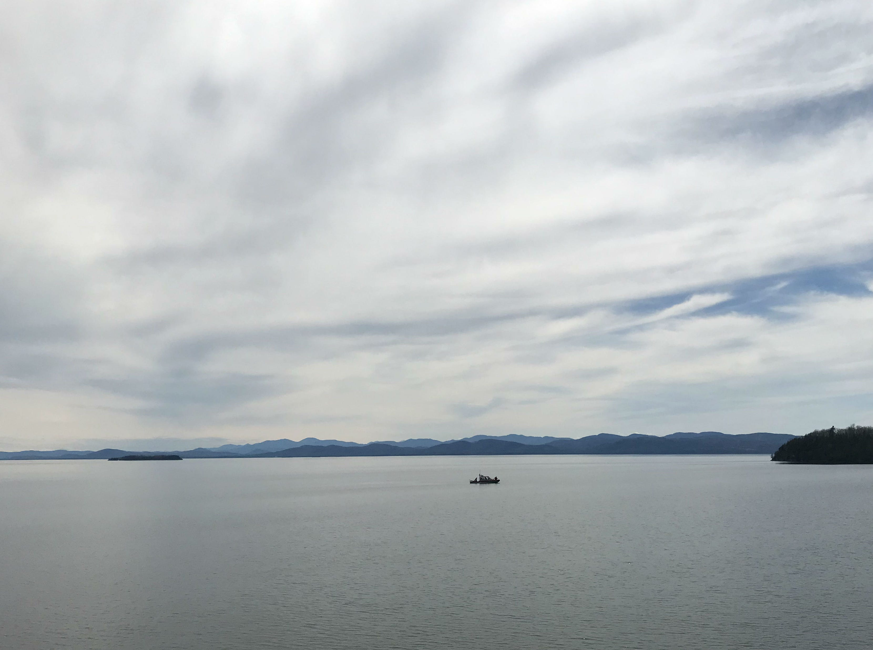 A fishing boat on Lake Champlain makes its way toward the mouth of the Winooski River on Sunday, May 5, 2019.