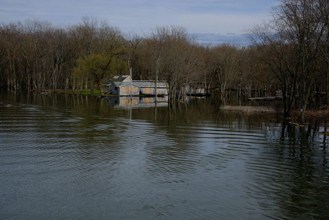 Waters on the Winooski River where it empties into Lake Champlain have risen to flood this boarded up house on the Burlington side on Sunday, May 5, 2019.