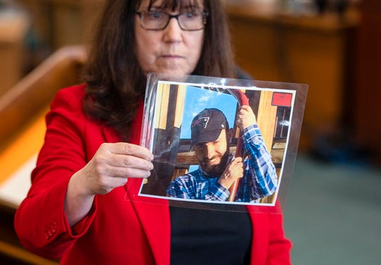 Prosecutor Susan Hardin shows a picture of Steven Bourgoin as he appeared in 2016 during his murder trial in Vermont Superior Court in Burlington on Monday, May 6, 2019.  Bourgoin is facing five counts of second-degree murder for a crash that killed five teenagers on I-89 in Williston in 2016.
