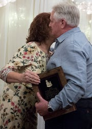 Fred Ashbrook hugs Patti Cavender after receiving the Director/Inn Keeper of the Year Award at the Christopher Conference Center in Chillicothe, Ohio, on May 6, 2019.