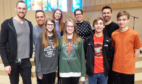 Loveland students Nadia Trombley, Molly Clemons, Simon Grome, Adam Zdrojewski , front from left, with their director and Break of Reality band members from left, back row: Patrick Laird, Ivan Trevino, Cicely Parnas, Rachel Bierkan, and Andrew Janss.