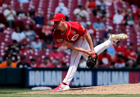 Cincinnati Reds starting pitcher Anthony DeSclafani (28) delivers a pitch in the sixth inning of the MLB National League game between the Cincinnati Reds and the San Francisco Giants at Great American Ball Park in downtown Cincinnati on Monday, May 6, 2019. The Reds won 12-5.