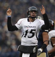 University of Cincinnati quarterback Tony Pike celebrates his game winning touchdown to Armon Binns against the University of Pittsburgh during the fourth quarter of their game played at Heinz Field in Pittsburgh, Pennsylvania Saturday December 5, 2009.