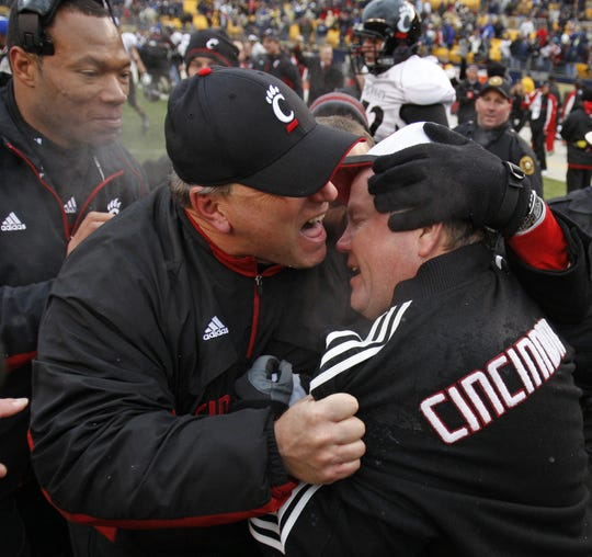 University of Cincinnati's Offensive coordinator Jeff Quinn, left, hugs head coach Brian Kelly following their win over the University of Pittsburgh in their game played at Heinz Field in Pittsburgh.