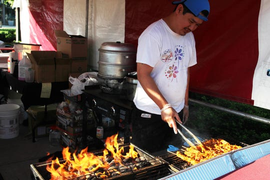 Cooking skewers at the Asian Food Fest in 2018