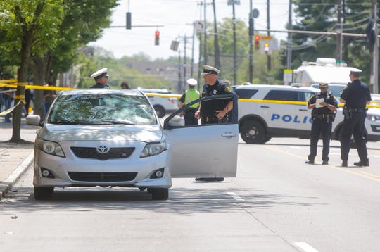 Police at the scene of a pedestrian crash on Reading Road in Avondale.